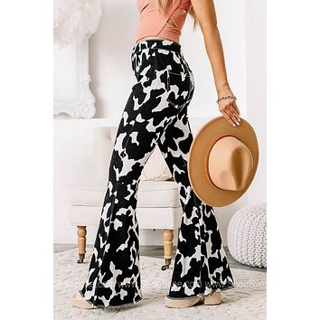 Need More Cowbell Cow Printed Bell Bottom Jeans