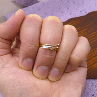 A tiny rose gold plated wing mult-task ring, above knuckle ring,adjustable finger ring,stackable ring, toe ring, little finger ring