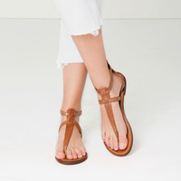 FLAT LEATHER CROSSOVER SANDALS