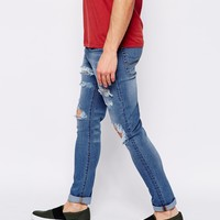 ASOS Super Skinny Jeans With Extreme Rips at asos.com