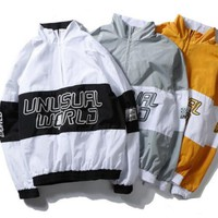 Unusual Worlds Windbreaker