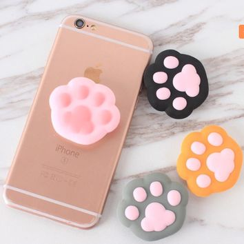 Silicone pop up stand and grip for cell phones or tablets Paw Prints
