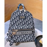 Dior backpack casual business travel backpack plus puppy pendant