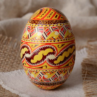Homemade designer decorative Easter egg pysanka painted with wax and aniline dyes