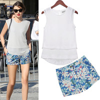 White Sleeveless Overlay Top and Blue Floral Print Shorts
