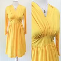 Miriam dress // 1970s bright sun yellow boho ultra draped jersy knit empire waist midi // ties in back // size M