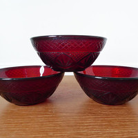 Three ruby red salad bowls by Luminarc Cristal d'Arques Durand, sold as a set