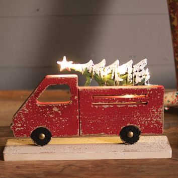 Red Truck Carrying Christmas Tree with Battery Lights