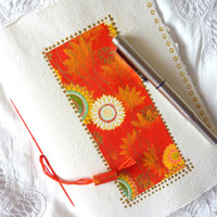 Abstract red design covers this Sketch Book, Journal or Notebook with blank pages