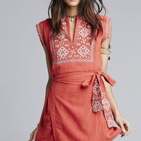 Whether you live the beach lifestyle year-round or dream of making the great escape. So cute wrap mini dress featuring a tonal textured weave cotton fabric and adjustable wrap skirt that has self-ties strap with embroidered detailing and a big panel in the