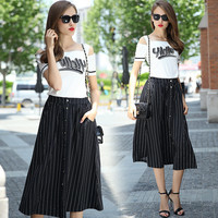 White and Black Graphic Print Cut-Out Sleeve Top and Striped Buttoned Midi Skirt