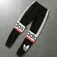 Adidas Fashion new letter leaf print stripe splice sports loose couple trousers pants Black