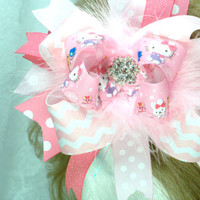 Hello kitty inspired over the top boutique hair bow marabou surrounds the rhinestone in center of the bow surrounded by hello kitty ribbon.