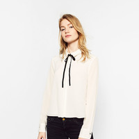 DOUBLE SHIRT WITH BOW COLLARDETAILS