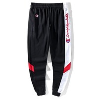 Champion New fashion side embroidery letter sports leisure splice couple pants Black Red