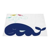 Cheerful whale playing with fish
