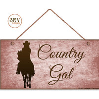 """Country Gal Sign, Rustic Decor, Grunge Pink Background, Weatherproof, 5""""x10"""" Wall Plaque, Gift, Lady Riding Horse, Western Sign, Cowgirl"""