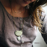 long original necklace made of green beach pebbles from Greece hand engraved