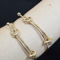 """S.I.N.N """"Simple Knot"""" Wire Tied Bangle in Gold - Accessories - Just In - SinnStyle.com"""