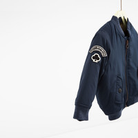 BOMBER JACKET WITH SLEEVE PATCHES