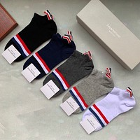 THOM BROWNE  A box of five pairs of new medium and short socks