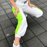 Fashion Street Running Pants Female Summer Elastic waist pants Wrapped Ankle Side Fluorescent Green Pants