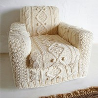hand knitted cream aran armchair slip cover by BiscuitScout