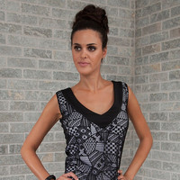 MAGGIE: Two layered black and white tank top.