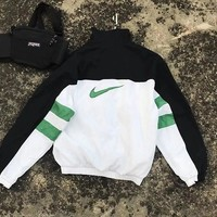 NIKE Green hook ultra-thin windproof sunscreen clothing black and white green color matching outdoor leisure travel sports jacket