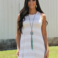 Our Time & Tide Dress - Oatmeal is just sweet and simple! It is a striped sleeveless tunic dress. It is flowy and not lined.