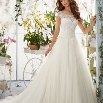 Embroidered Lace Overlays the Bateau Bodice on Soft Net Morilee Bridal Wedding Dress   Style 5403   Morilee