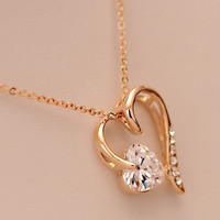 Golden peach heart pendant necklace