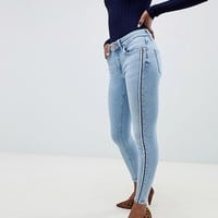 River Island Petite Amelie skinny jeans in light wash at asos.com