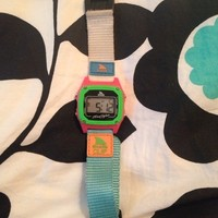 A color filled shark watch that is digital