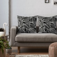 'Leaves in white' Throw Pillow by juliagrifol