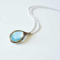 SUMMER SALE - Aqua blue glass framed pendant necklace.