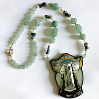 "Beautiful 1970's Signed Angel Pendant by Hawaiian Artist Lee Sands in Mother of Pearl Inlay on a 20"" Beaded Necklace set in Lucite"