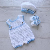 White baby boy overall with matching hat and booties