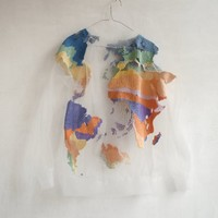 REUSING A THREAD: IÑIY SANCHEZ'S SUSTAINABLE EARTH SWEATER - A FASHION ODYSSEY BY PREMSELA(NL) I.