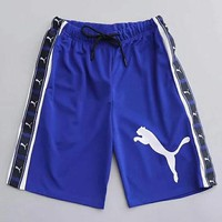 PUMA collage logo is used to string together pairs of shorts for casual sport