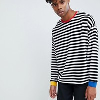 ASOS DESIGN oversized stripe velour long sleeve t-shirt with contrast ribs at asos.com