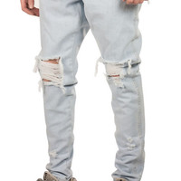 The Ripped Tapered Denim Jeans in Bleached Indigo