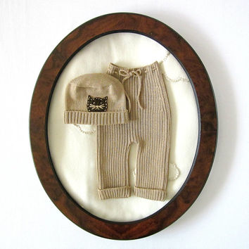 Knitted ribbed pants camel and hat with a little cat. 100% wool.