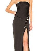 Lace-up detail with silver tone grommet accents Front slit