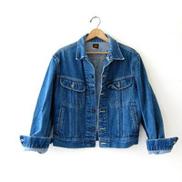 Vintage LEE Jean Jacket. Denim Jacket. Distressed and worn in. Medium wash denim jacket