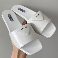Prada Triangle button series flat slippers