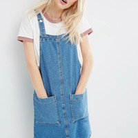 ASOS | ASOS Denim Mini Pinafore Dress In Mid-Wash Blue at ASOS