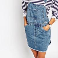 ASOS Denim Classic Dungaree Dress With Raw Hem in Mid Wash Blue