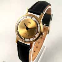 """SUPER RARE Women's watch called """"Zaria SKELETON"""" see through back!!! This gold plated Vintage watch comes with brand new leather strap."""
