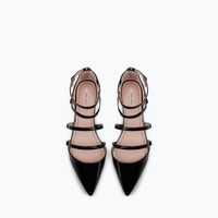 Flat court shoe with ankle strap